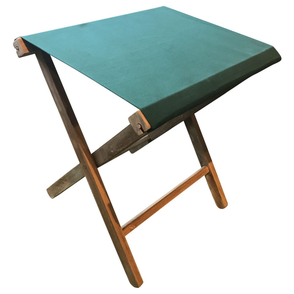green folding wooden stool
