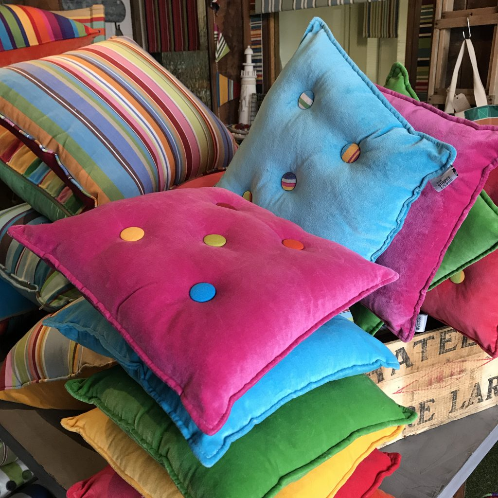 small velvet cushions with striped buttons